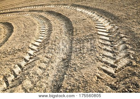 Big wheel tracks on the ploughed field.