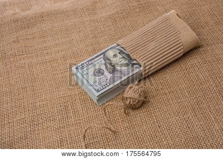 Spool Of Linen Spool Is Placed On Us Dollar Banknotes