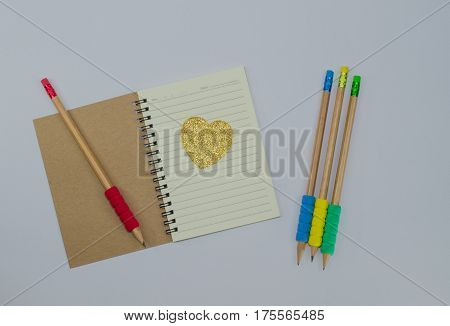 Recycled paper notebook open front cover on white background