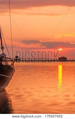 Silhouette of the yacht at the sunrise.