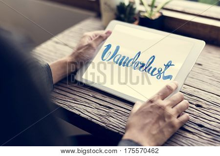 Man Hand Holding Tablet Wooden Table Wanderlust