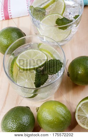 refreshing drink mineral water with organic lime and lemon balm