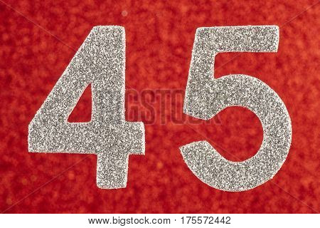 Number forty-five silver color over a red background. Anniversary. Horizontal