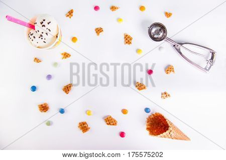 White Background With Colorful Candies, Pieces Of Waffles, Ice Cream And Empty Ice Cream Cone. Place