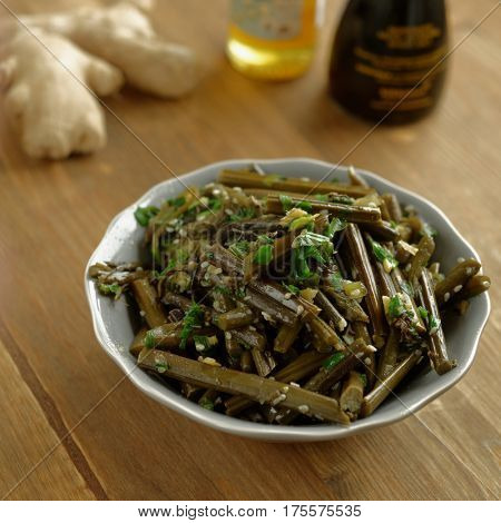 Sauteed bracken fern salad with sesame oil and seeds