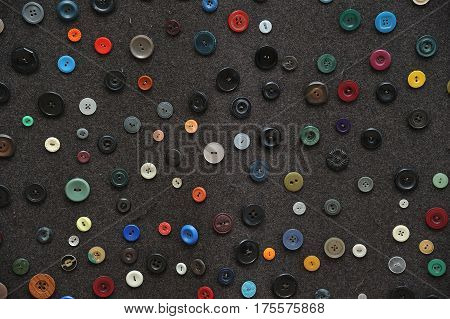 Various buttons spread on a dark floor