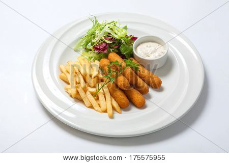 Fish Sticks With Sauce, Fried Potatoes And Fresh Salad Lettuce On A White Plate