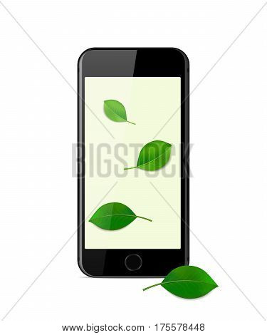 Black modern smartphone on a white background with green leaves