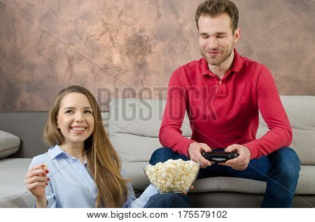 Couple Enjoys Free Time And Playing Video Games.
