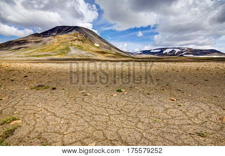 Patternd ground with polygons in beautiful primordial icelandic highland on a clear sunny day with blue sky and white clouds. Kaldidalur, Iceland.