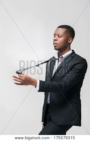 Office worker puppet unable to express opinion and will. African american employee on grey background with free space.