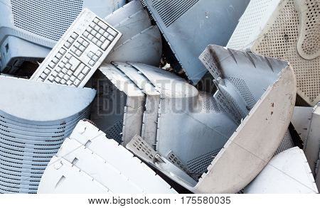 Obsolete computer monitors and keyboards on the landfill.