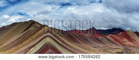 Panorama of Rainbow Mountain outside of Cusco, also known as Ausangate.  Its color is due to mineral erosion.