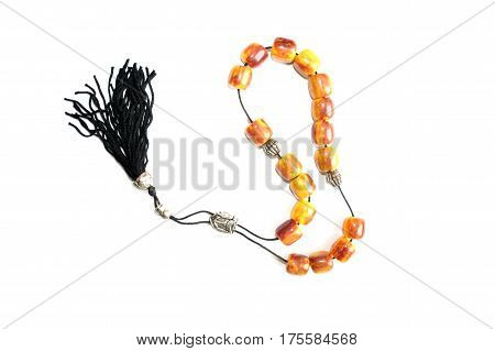 Rosary isolated on white background. beads made of wood