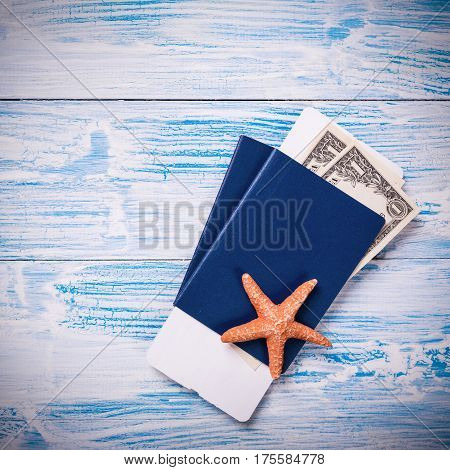 Passports With Boarding Pass And Dollar Banknotes On Wooden Background