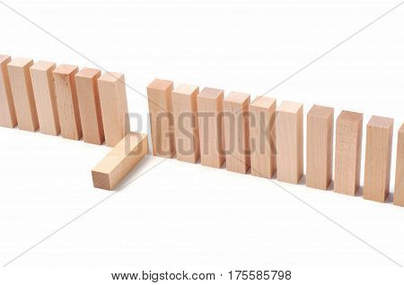 The concept of fatigue, heavy management work, dismissal and stress. Wooden blocks on a white background