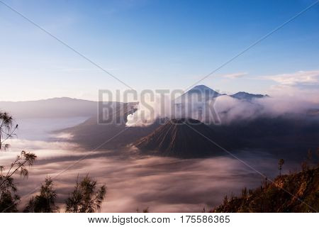 Mount Bromo surrounded by mist an active volcano and part of the Tengger Semeru National Park in East Java Indonesia.