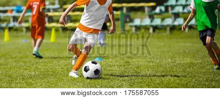 Football Soccer Match for Children. Kids Soccer Teams Playing Training Game on Pitch. Boys Running and Kicking Football Ball. Youth Soccer Footballers Competition