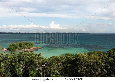 High panoramic point of view looking over the turquoise tropical ocean horizon in the afternoon of belitung island Indonesia.