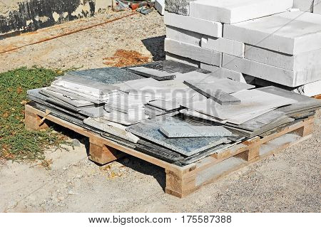 Stack of brick and material waste on construction site