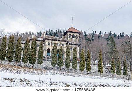 The Cantacuzino Palace (palatul Cantacuzino) From Busteni, Romania, Winter Time With Snow And Ice
