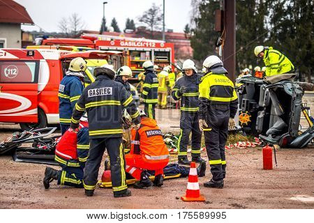An accident scene on the road with  fire fighter.