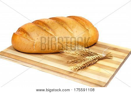 French bread with spikelet and cutting board on white background. Close up