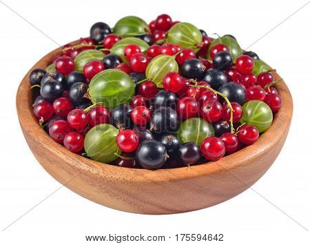 Various Kinds Of Fresh Berries In A Wooden Bowl On A White