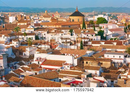 Roof of the old city and church Iglesia del Colegio de Santa Victoria, aerial view from the bell tower at the Mezquita in Cordoba, Andalusia, Spain