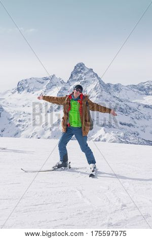 Alpine Skiing In The High Mountains. Active Positive Skier.