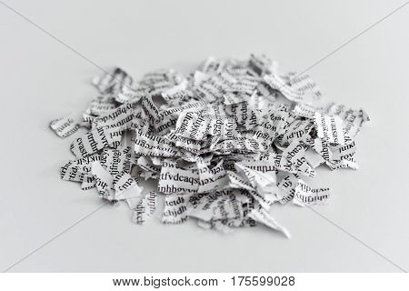 a printed letter or document broken into a thousand pieces