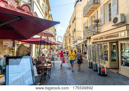 Antibes, France - June 27, 2016: day view of main street Rue de la Republique with tourists in Antibes France. Antibes is a popular seaside town in the heart of the C