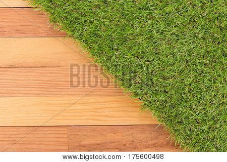 Synthetic Green Grass And Wooden Wall, Natural Background.