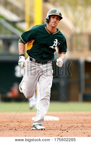 SCOTTSDALE, AZ-MAR 6: Oakland Athletics left fielder Sam Fuld rounds the bases against the Arizona Diamondbacks at Salt River Fields at Talking Stick on March 6, 2014 in Scottsdale, Arizona.