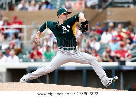 SCOTTSDALE, AZ-MAR 6: Oakland Athletics starting pitcher Sonny Gray (54) pitches against the Arizona Diamondbacks at Salt River Fields at Talking Stick on March 6, 2014 in Scottsdale, Arizona.
