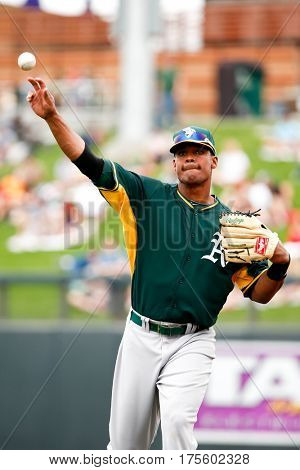 SCOTTSDALE, AZ-MAR 6: Oakland Athletics right fielder Michael Taylor (23) warms up against the Arizona Diamondbacks at Salt River Fields at Talking Stick on March 6, 2014 in Scottsdale, Arizona.