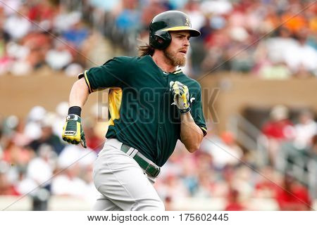 SCOTTSDALE, AZ-MAR 6: Oakland Athletics outfielder Josh Reddick rounds the bases against the Arizona Diamondbacks at Salt River Fields at Talking Stick on March 6, 2014 in Scottsdale, Arizona.