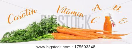 panorama of fresh carrots with bottle of healthy juice in front of a white background. vitamin a b c e