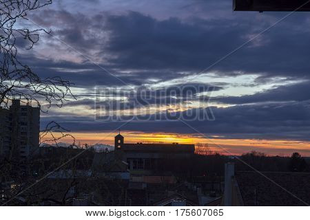 Colorful Sunset in the City. Silhouette City Skyline.