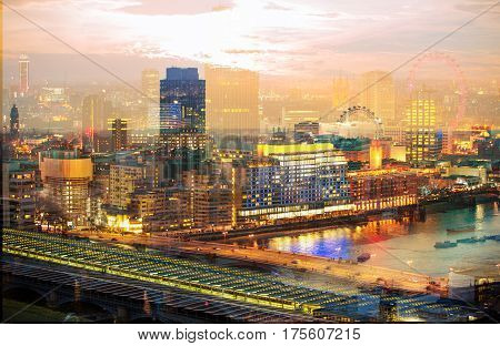 City of London at night. Multiple exposure image includes Walkie-Talkie building, City of London financial aria at sunset