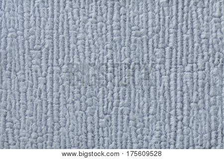 Light blue fluffy background of soft fleecy cloth. Texture of textile closeup.