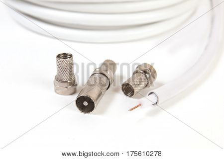 TV coaxial cable and connectors on white background