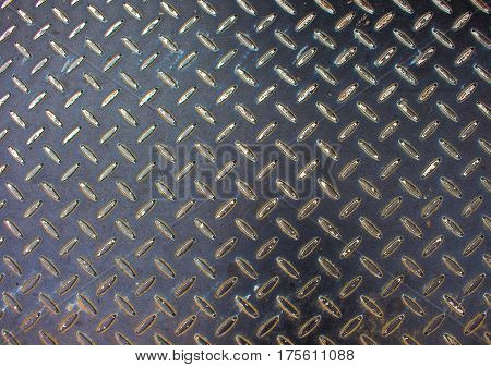 Metal texture. Iron floor surface photo. Metal relief for walking path in construction area. Rustic metallic blocks on road. Stainless plate standard ornament. Monochrome industrial background
