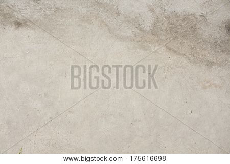 Warm concrete texture photo for background. Shabby chic backdrop. Natural stone surface with drips and dirt. Distressed texture in beige shades. Obsolete concrete floor top view photo. Grey stone