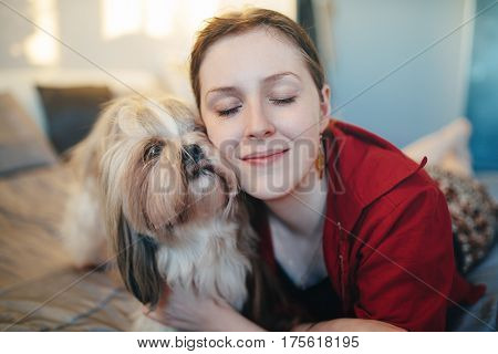 Young woman with shih tzu dog portrait. Love and care to pet concept.