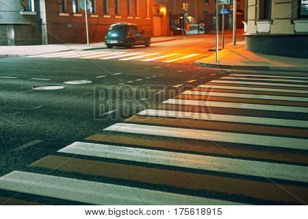 Crosswalk in city at night. Pedestrian safety concept.