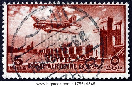 EGYPT - CIRCA 1953: a stamp printed in Egypt shows Delta Dam and DC-3 Plane circa 1953