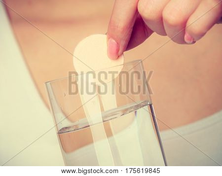 Woman Holding Glass With Water And Effervescent Tablet