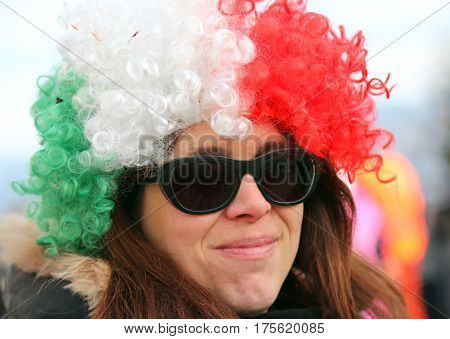 beautiful girl with a big wig red white green and black glasses