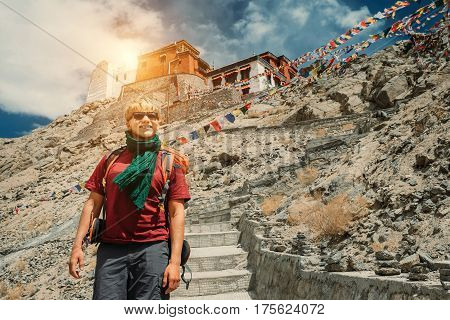 Young man near the tibetan monastery Tsemo Gompa in Leh North India